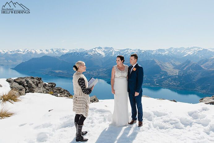 wedding ceremony. Bride and groom marry on The Ledge. Destination Heli weddings Queenstown.