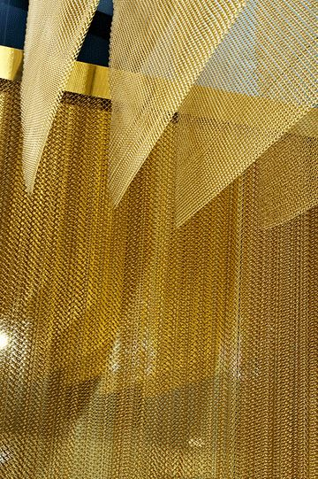 This metallic mesh is a plus...this can be used to create walls within the booth