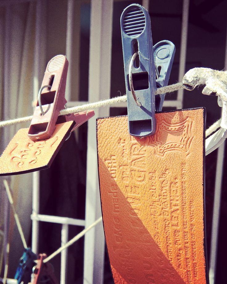 Enjoying the #fruits of #winter.  #Tangerine!  #WorkshopLife #LeatherWorkshop #LeatherCraft #LeatherWork #MadeInIndia #India #NewDelhi #Leather #Details #BeautifulBags #Potd #Instadaily #Instacool #Instagood #Craft #Art #Branding #CareLabel #CompositionLabel