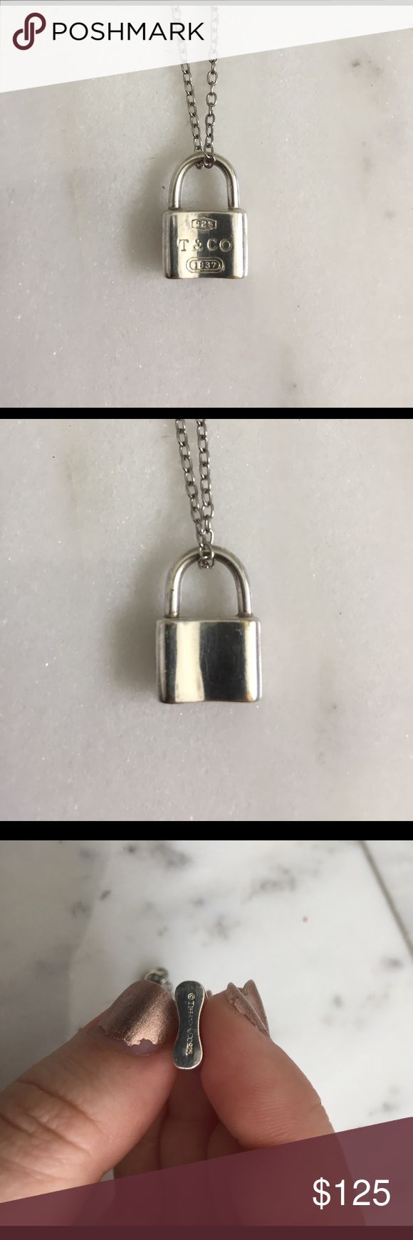 • Tiffany & Co. Lock Pendant • In great condition. There is some minor wear from being worn and the bottom is a bit worn so some of the letters have started to fade. It's super cute and I would keep it but I got this from my ex-boyfriend and I would really just like to get rid of it. Chain is not included. Tiffany & Co. Jewelry