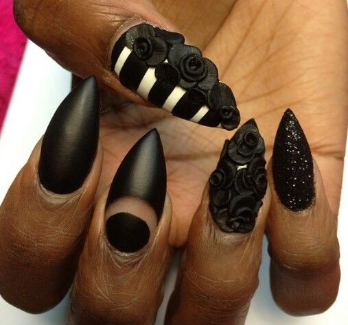 Black floral striped matte rounded stiletto nails