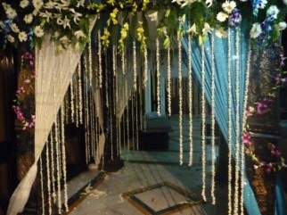 Jasmin flower garlands on the curtained entry with flower canopy