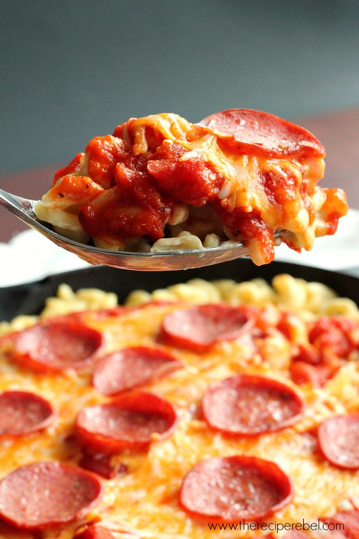 Pepperoni Pizza Mac and Cheese: made completely in one pot or skillet! Because the only way pizza could get better is if you made it on a mac & cheese crust. www.thereciperebel.com