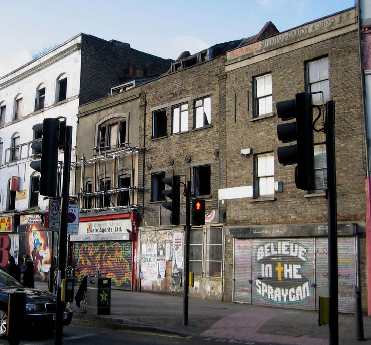 Derelict terrace at the junction of Redchurch Street and Bethnal Green Road includes two 18th century weaver's houses