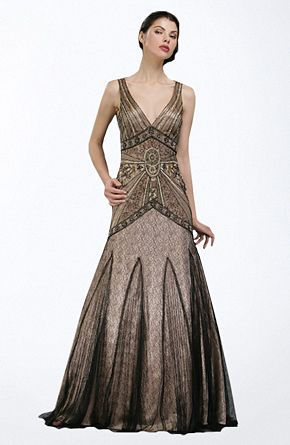 Black and gold have been used again. Art Deco fashion inspired the detailing of the bodice, with the strong angular line and geometric shape, all coming together at a central point.