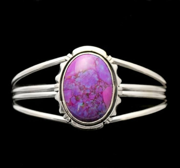 Sterling silver cuff bracelet with a Magenta Turquoise stone in a traditional silver setting http://nativeamericanstuff.net/magenta_turquoise_jewelry.htm