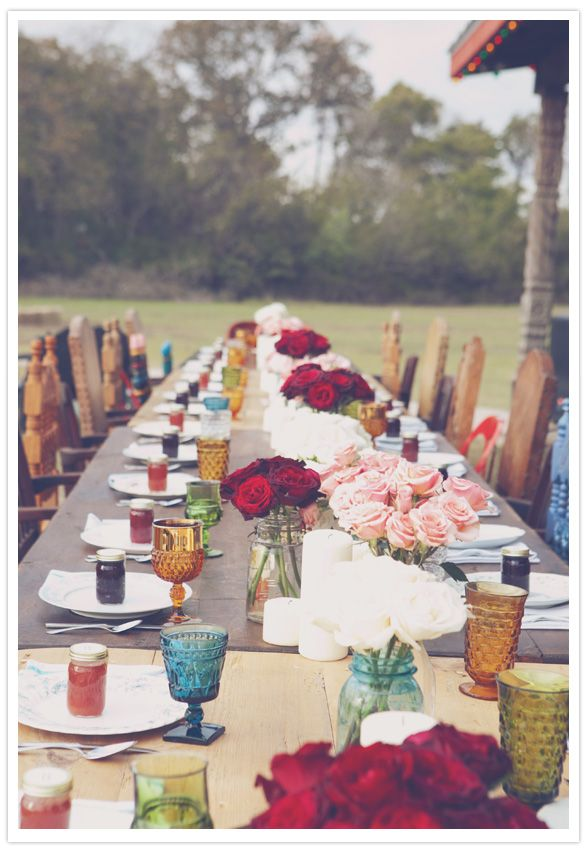 The Boho Dance Beautifully Bohemian Wedding Decor Mismatched Chairs Frosted Jewel Tone Glasses Plus Lush Red Roses Make This A Lovely Outdoor