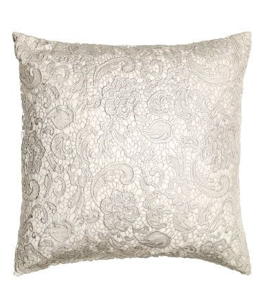 "Cushion cover with lace and printed silvery design at front. Concealed zip.  19 3/4 x 19 3/4"". $17.95"