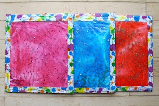 Gel sensory pads better secured than many...like this activity for seniors or kids. (and draw tic-tac-toe on bag and add flat marbles for markers)