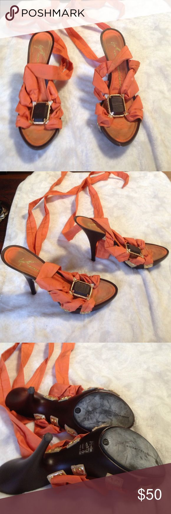 Giuseppe heels 100% authentic. Worn but life left. Very pretty heels that lace up Giuseppe Zanotti Shoes