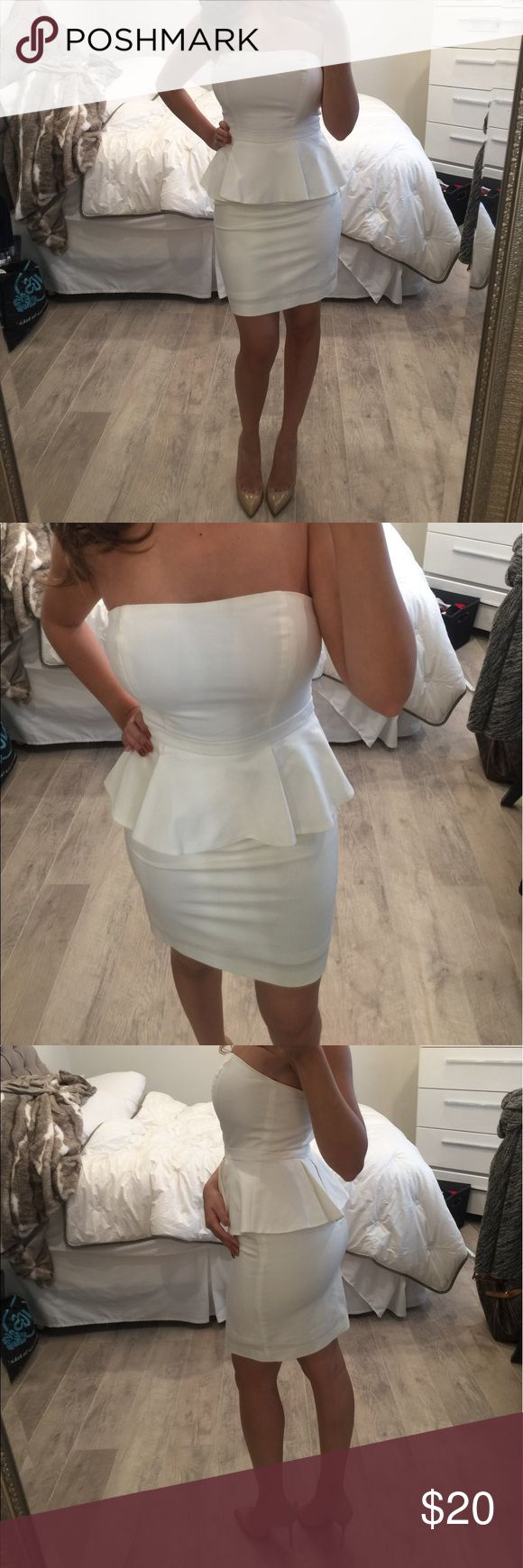 White peplum dress. Perfect for Kentucky derby. Perfect white strapless Peplum dress. Never worn new with tags. Would be super cute for Kentucky derby or Belmont type parties. Forever 21 Dresses Strapless