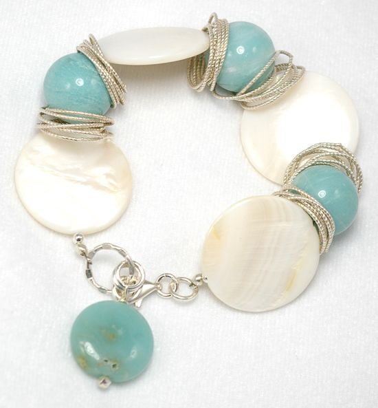 DIY: 25 Trendy Handmade Bracelets.  i like the idea of the larger rings in b/t elements, as opposed to using regular spacers
