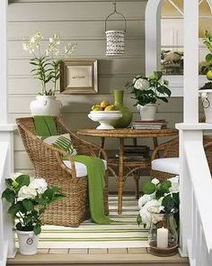 Talk about all the comforts of home!  Using wicker which is easy to move is a great idea because I think when the elements get a bit out of control...you have to move these pretties to a safe place. One way or another...this space is inviting to all and an extension of the home.