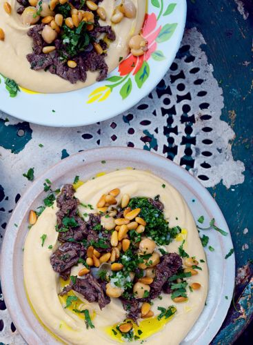 Hummus kawarma is the Lebanese name given to freshly made hummus, topped with fried chopped lamb. This recipe from Yotam Ottolenghi's Jerusalem makes a small meal or a starter in a bowl and is one of the most sensational things you will ever taste.