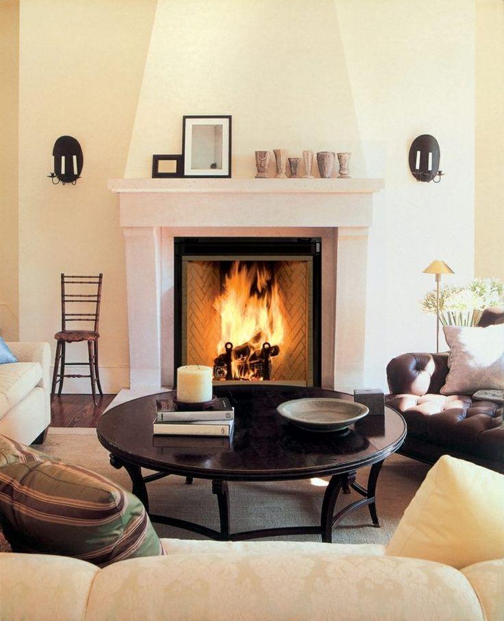cheminée ouverte design idée canapé design table ronde salon fauteuil coussins idées