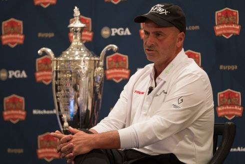 Rocco Mediate, defending champion of the Senior PGA Championship tournament, sits next to his trophy during a press conference for this year's Senior PGA tournament, to be held at the Trump National Golf Club in Potomac Falls, Virginia. Mediate, along with PGA of America president Paul Levy and Eric Trump were spoke to members of the press from the Trump International Hotel in Washington on Thursday, March 9, 2017. (MICHAEL S. DARNELL/STARS AND STRIPES)