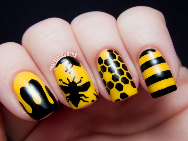 Rich Yellow Polish Color With Yellow Bee Silhouttes Nail Art Design