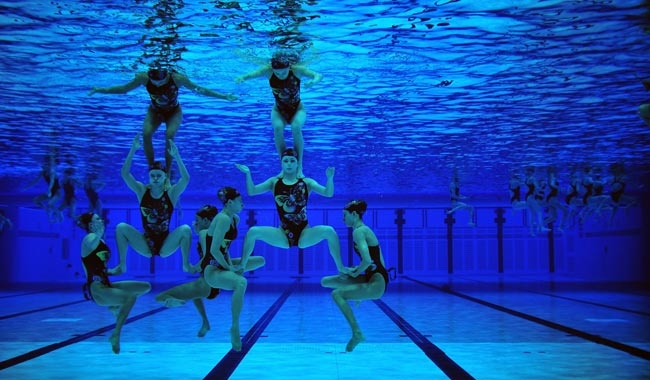 Teams warm-up for the synchronised swimming competition ...cool.. wow..have a look at this cool bag @ www.spacebags.co.uk