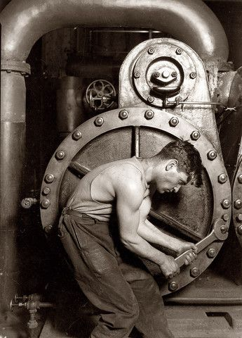 """Powerhouse Mechanic by Lewis Wickes Hine. This photo of """"powerhouse mechanic and steam pump"""" is one of Lewis Wickes Hine's most famous works. 1920. Company photo courtesy of Shorpy. (s/n/1284)"""