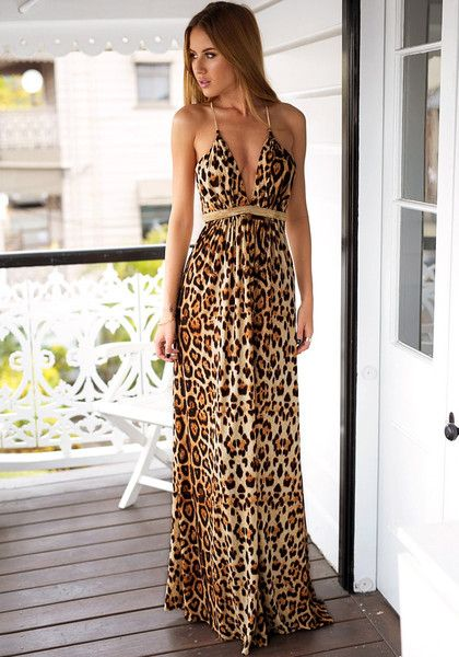 Model in leopard print prom dress looking right side