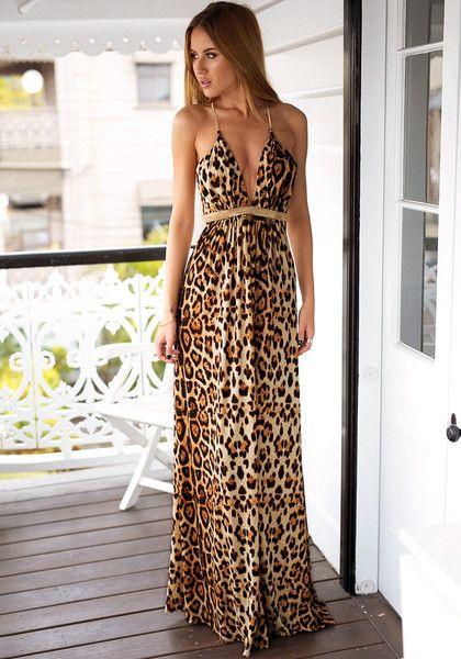 Model in leopard print prom dress looking right side