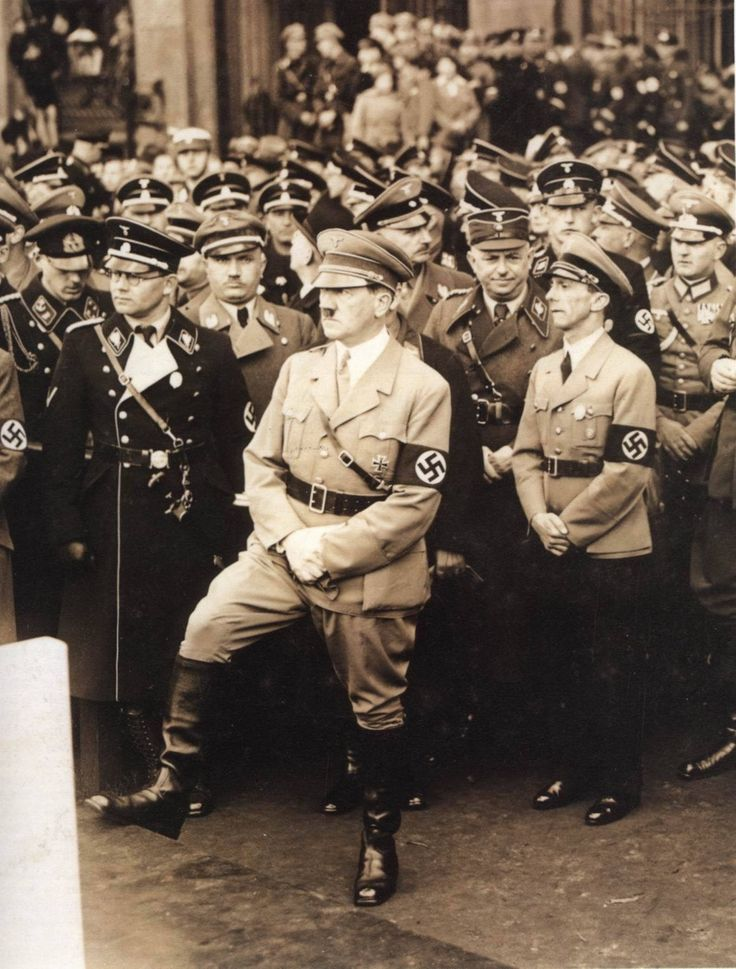 Adolf Hitler preparing to go on stage and speak to the many legions of fellow NSDAP Partei Kameraden during a National Socialist Party Rally in Berlin.