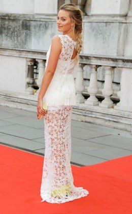 Margot Robbie's fresh, summery braid is perfect for a beach wedding.