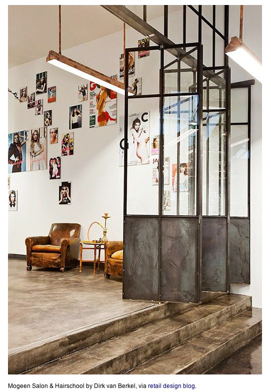 Fantastic metal accordian doors with stained concrete flooring. LOVE.