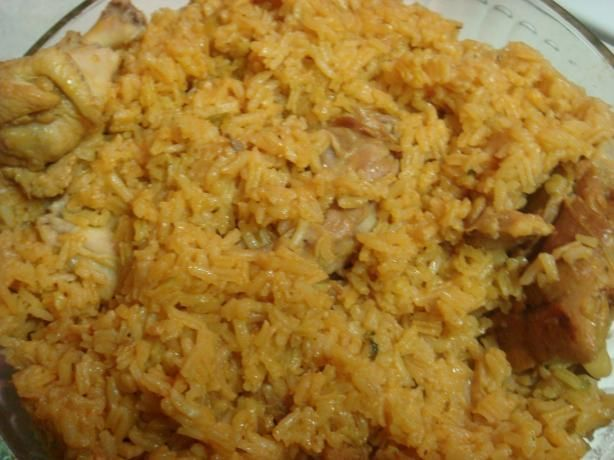 Dominican Locrio De Pollo ( Rice and Chicken) from Food.com: One of my childhood favorites, had it quite often. Traditionally they do add the olives and sometimes even capers..but I don't like them.