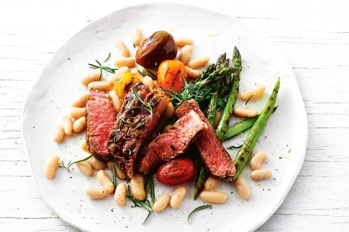 Rosemary steak with charred asparagus and white bean salad