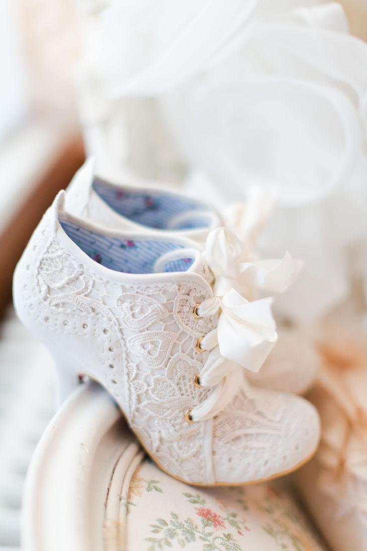 Unique bridal shoe ideas, white wedding booties, lacy shoes, ribbon shoe laces // Ivan & Louise