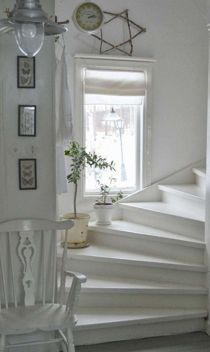 Lovely staircase with the little window.