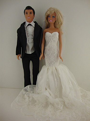 a set of 2 an elegant bright white wedding gown with veil and a black tux
