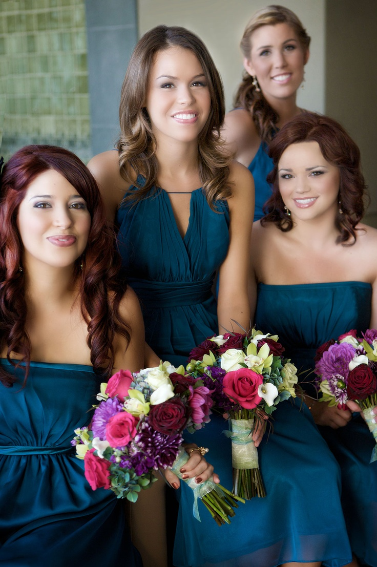 Vibrant Dahilas, Hydranges and Roses mixed with Orchids were designed in these bridesmaids bouquets against their Teal Dresses made stunning pictures