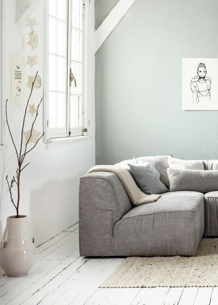 White, grey and light interior / living room with white wooden floors and a grey wall, grey canvas vtwonen couch Lazy, a big off-white vase by Nijhof, natural rug by Zuiver and accessoires by Sukha Amsterdam, All the Luck in the World, Studio Elke van den Berg , H&M Home, Het Kabinet, Bodilson, Six and Sons, The Cherry on Top, Livv Lifestyle and De Oude Plank | styling Kim van Rossenberg, photography Sjoerd Eickmans, vtwonen May 2015
