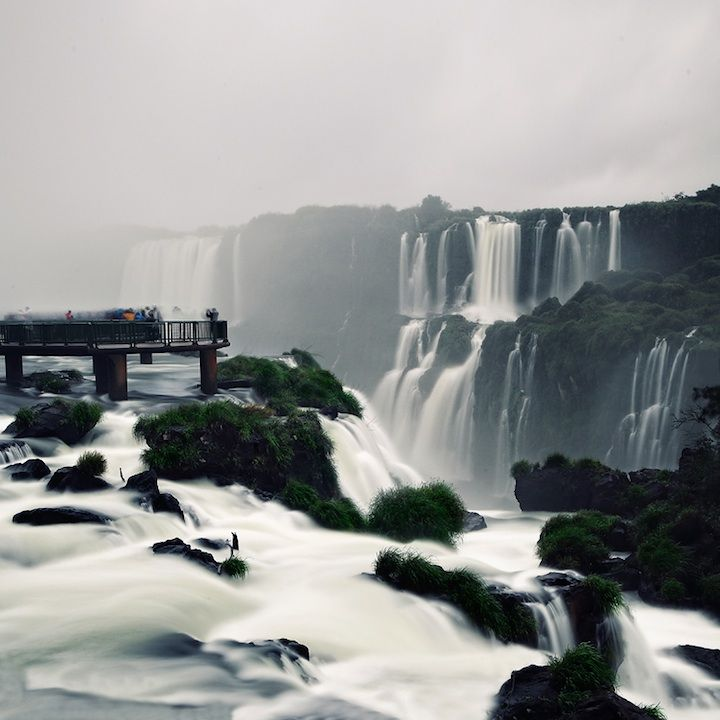 "Last winter, fine art photographer Hüseyin Kara visited Brazil and came back with these stunning photos of the world famous Iguazu Falls. Located at the Argentina-Brazil border, the falls take the shape of an elongated horseshoe or a reverse letter ""J"". At 1.7 miles wide, Iguazu Falls is three times wider than North America's Niagara Falls."