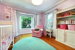 Traditional Kids Bedroom with Hardwood floors, Built-in bookshelf, Bay window, flush light, Crown molding