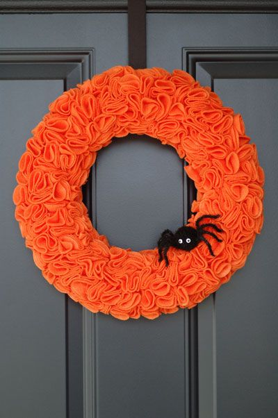 The secret behind that pretty swirly texture? Pinked felt circles, folded and pinned. Add a spooky accent, like this little spider, to give your DIY wreath a true Halloween feel. Click through for the tutorial and more DIY Halloween wreaths.