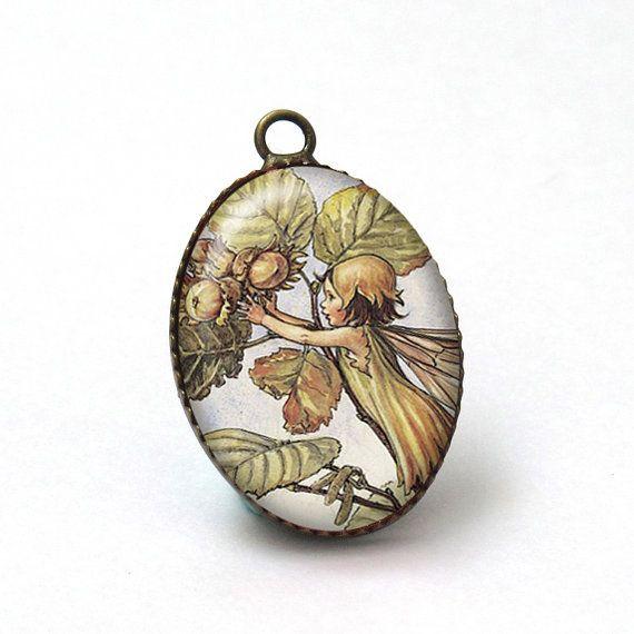 1 pc Hazelnut Jewelry Flower Fairies Pendant by mixnmatchsupplies, $1.50