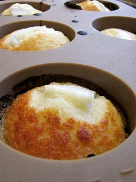 Bibingka Muffins:  1½ cups rice flour  1 tablespoon baking powder  pinch of salt  ¾ cup powdered sugar  3 eggs, beaten until thick and lemon-colored  1 cup coconut milk  4 tablespoons melted butter   grated or scraped fresh coconut  butter and sugar, optional