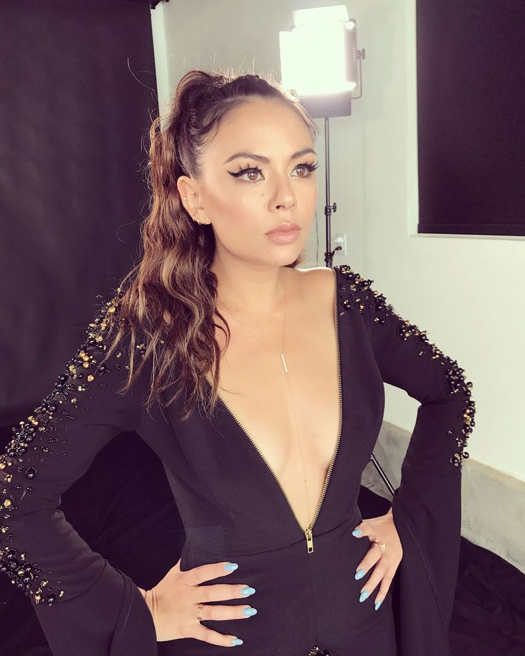 Janel Parrish looks so glamorous in this embellished black dress and ponytail