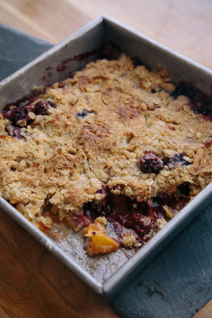 This gluten-free peach and blackberry crisp is so delicious with fresh peaches and blackberries, ripe in season, and our gluten-free flour. You'll want to make some today! #glutenfree #glutenfreebaking  www.glutenfreegirl.com