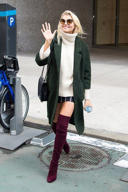 Rachel Hilbert A theme emerges with Hilbert's get-up: jeans have been replaced with mini skirts, T-shirts with fluffy jumpers, and trainers with thigh-high suede boots - topped off with a Chanel Boy bag and giant sunglasses, in Hilbert's case.