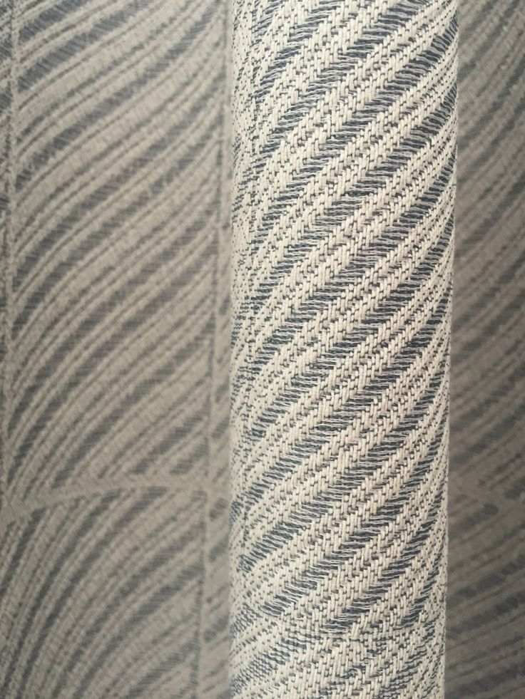 The delicate Utopia curtain by Doshi Levien. The pattern is inspired by the surface of concrete, glass and weathered metal