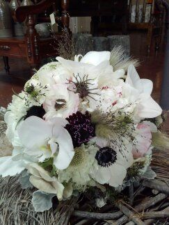 I made this beautiful wedding bouquet with white Peonies, white Anemone, white Phalaenopsys orchid blooms, white Scabiosa, pale pink Poppy flowers, burgundy Scabiosa, Nigela pods, Explosion grass, Bunny tail grass, Dusty Miller.