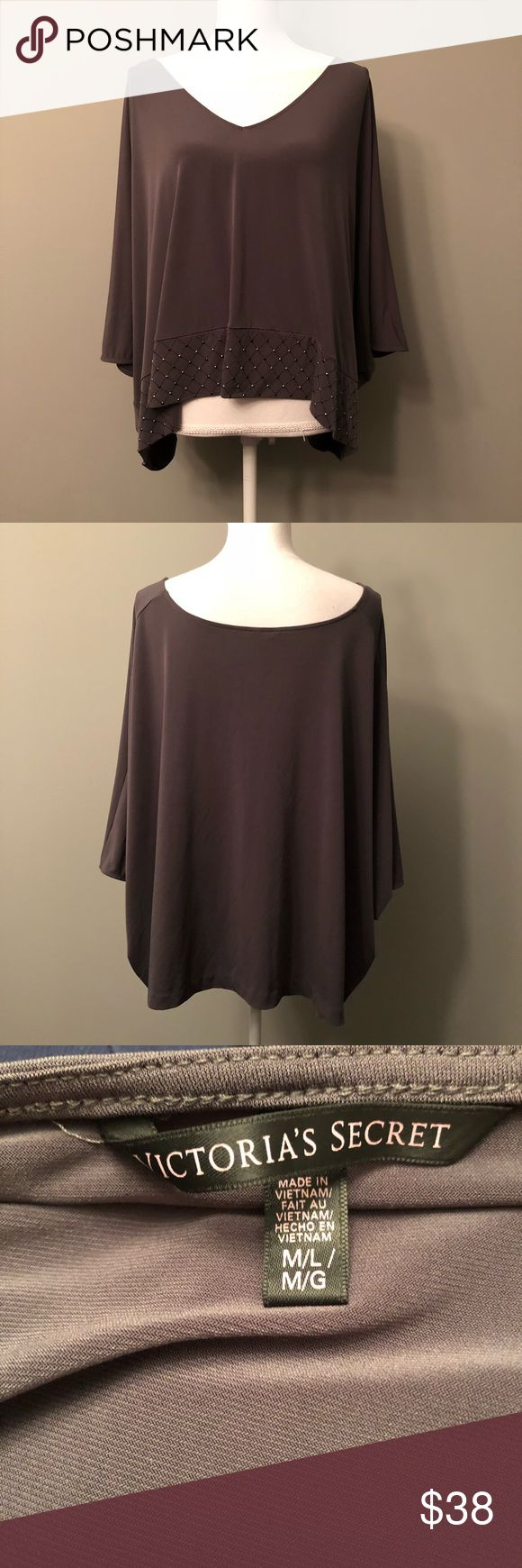 Victoria's Secret poncho shirt charcoal gray M/L Preowned in like new condition Victoria's Secret top size medium/large. A dark charcoal color. Dolman , poncho style. Some bling on the bottom hem in front only. Slouchy loose fit . Beautiful top.  No stains , snags or wear  Smoke free / pet free  Measurements are not available being the fit of the top. Victoria's Secret Tops