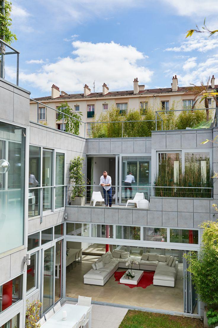 Fenêtres et baies vitrées en accordéon en aluminium. Réalisation de Belisol Chantilly.