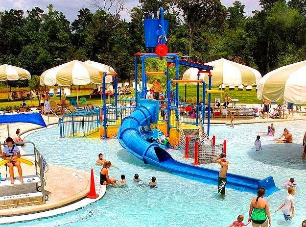 Rob Fleming Aquatic Center - The Woodlands, Texas. Things to do with the kids! Equipped with a lazy river, pool, water slides, splash pad and kiddie play area.