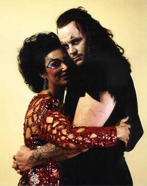 The Undertaker hugging Sensational Sherri: 1990s  Not sure when this photo was taken, but it's fantastic.