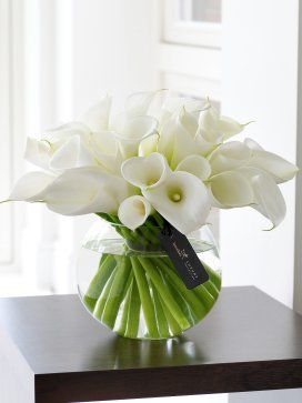 This immaculate presentation of calla lilies is the perfect gift for those who appreciate elegance, simplicity and fine contemporary design. Each smooth white fluted lily has been carefully placed in the clear glass globe vase to create a harmonious display which captures the extravagance and grandeur of the calla lily. http://www.interflora.co.uk/catalog/product.xml?product_id=2539856;=1